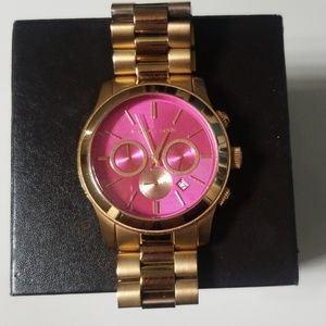 Rose gold with pink face Michael Kors watch
